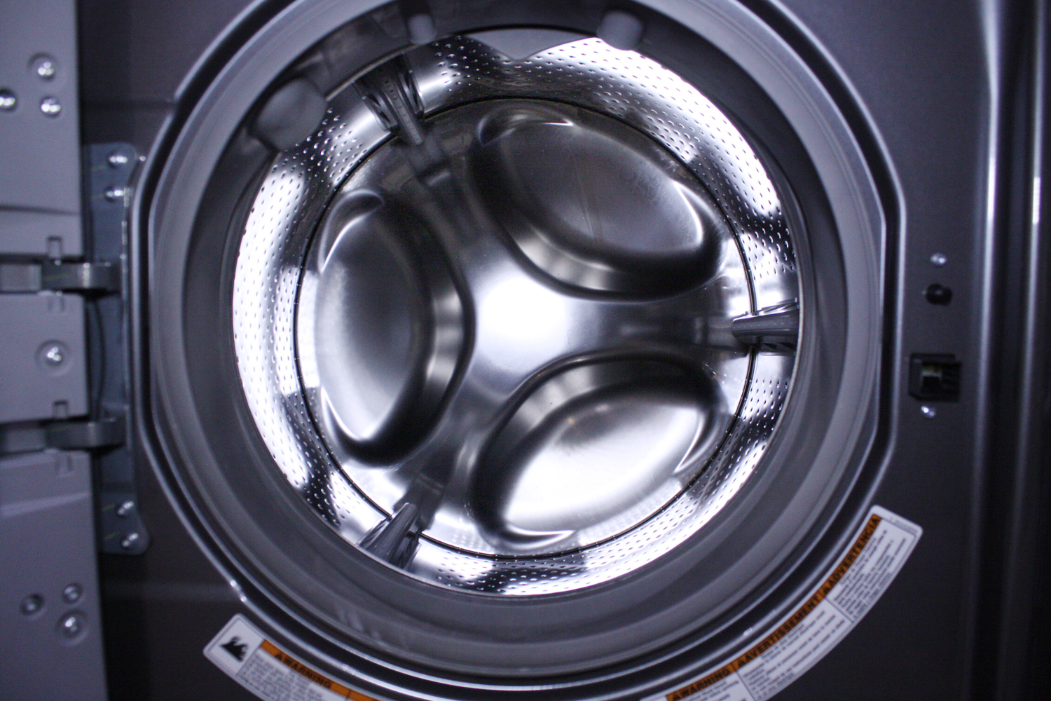 how to remove change from front load washer inner basket