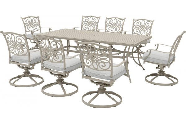 """Large image of Hanover Traditions 9-Piece Outdoor Dining Set In Sand/Beige With 8 Swivel Rockers, 42x84"""" Cast Table - TRADDNSD9PCSW8BE"""