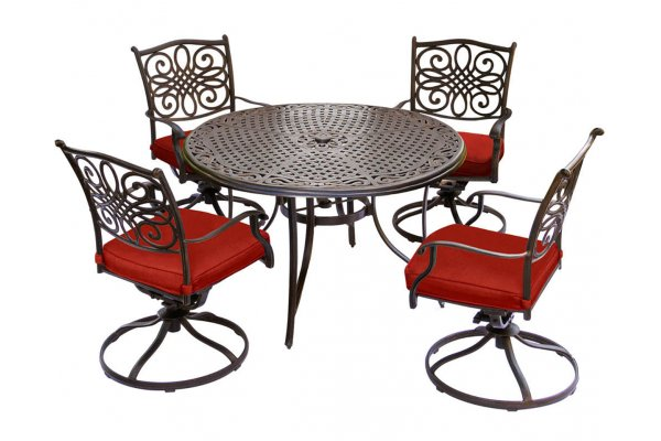 """Large image of Hanover Traditions 5-Piece Outdoor Dining Set In Red/Bronze With 4 Swivel Rockers, 48"""" Cast-Top Table - TRADDN5PCSWRED"""
