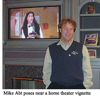 Mike Abt poses near a home theater vignette