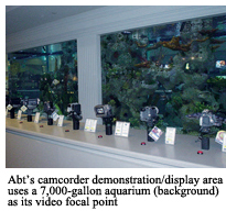 Abt's camcorder demonstration/display area uses a 7,000-gallon aquarium (background) as its video focal point