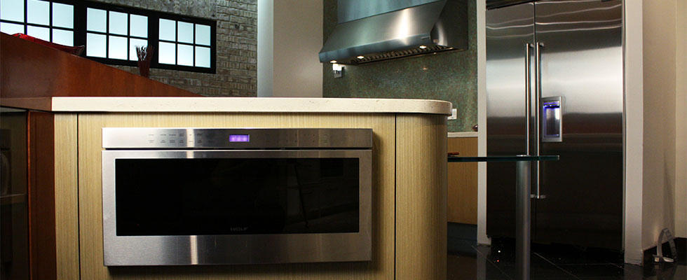 Sub-Zero and Wolf Full Kitchen - Featuring Wall Ovens, a Cooktop, and a Built-in Refrigerator