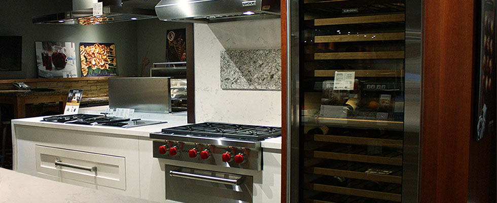 Sub-Zero Wolf Living Kitchen at Abt - Featuring a Refrigerator, cooktop, and hood