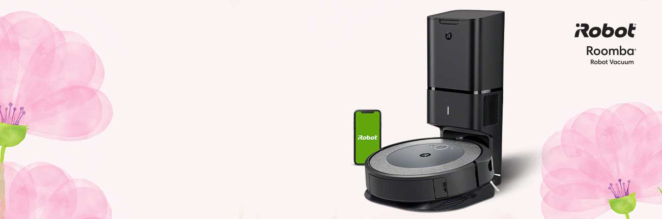 Roomba vacuum docked on base