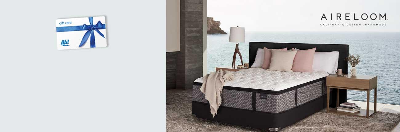 Airloom mattress set against window overlooking the ocean